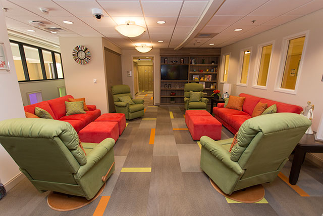 a room with brightly colored chairs and couches